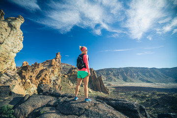 Reached life goal, girl looking at inspirational landscape