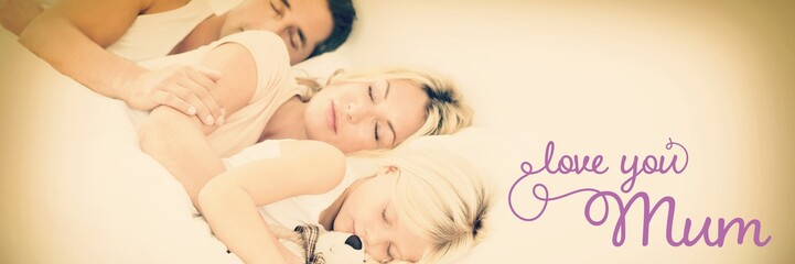Composite image of family sleeping together