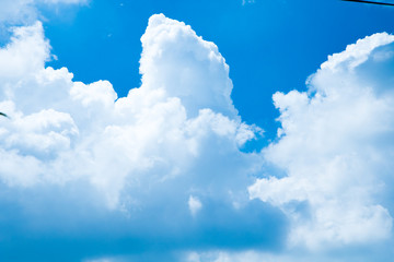White clouds in blue sky sunny day