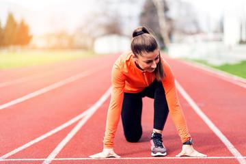 Athlete woman at starting line