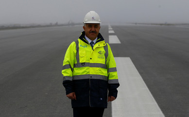 Transport and Maritime Minister Ahmet Arslan stands on the tarmac in the construction area of Istanbul's third international airport