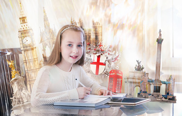 Pretty english girl with books, studying. English educational concept image with famous artefacts at the background. Big Ben,  Victoria monument, Tower bridge, Nelson column, Parliament, Cambridge.