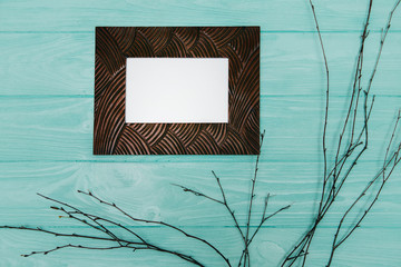 wooden photo frame, on blue background.
