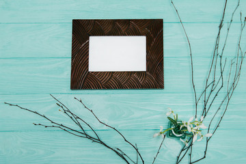wooden photo frame, on blue background.