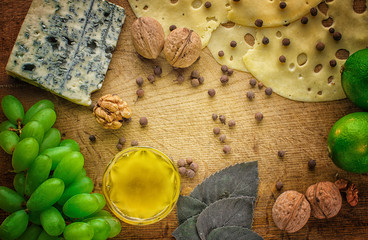 Different types of cheeses with empty space background. Top view