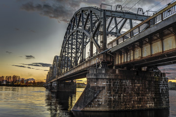Wall Mural - View of the railway bridge across the Daugava River during the sunset in Riga