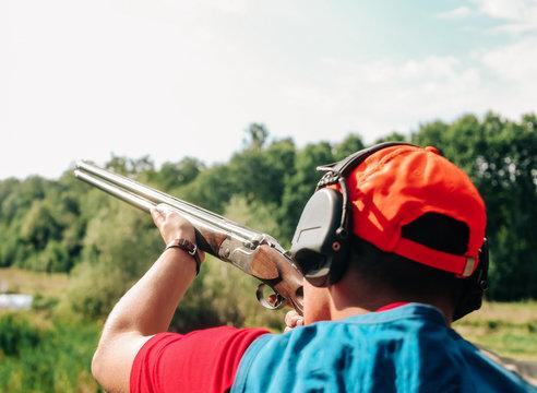 sport shooting  plates shotgun man aiming