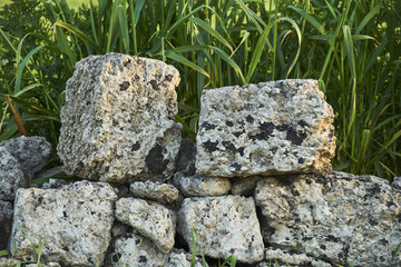 Old stones of a dry stone wall in Salento - Italy