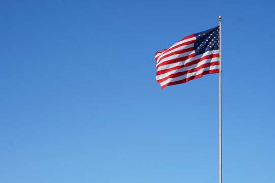The American flag floats in the air proudly.