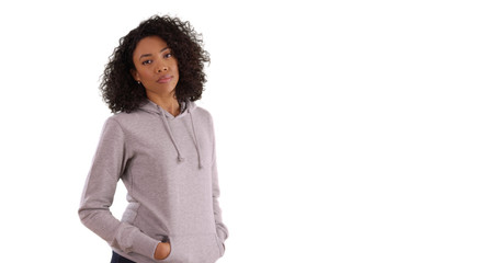 Casual black female wearing gray hoodie posing for camera on white copy space