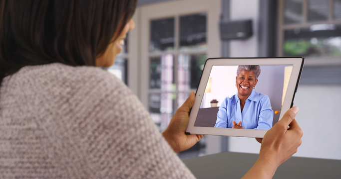Mother and daughter spending quality time together video chatting