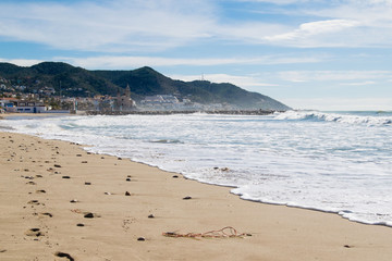 The beautiful town of Sitges,  Landscape of the coastline in Sitges, high tide