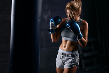 Sexy girl boxer trains in boxing hall