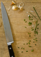 Cutting board with knife and ingredients