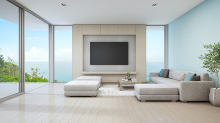 Sea view living room of luxury beach house with glass door and wooden terrace. Large white sofa against blue wall near TV in vacation home or holiday villa for big family. Hotel interior 3d rendering.