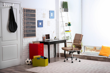 Modern child room interior with desk and laptop