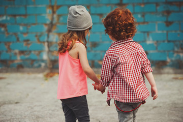 hipster boy and girl in park