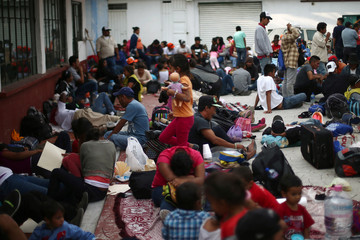 Central American migrants, moving in a caravan through Mexico, rest as they arrive to Tultepec