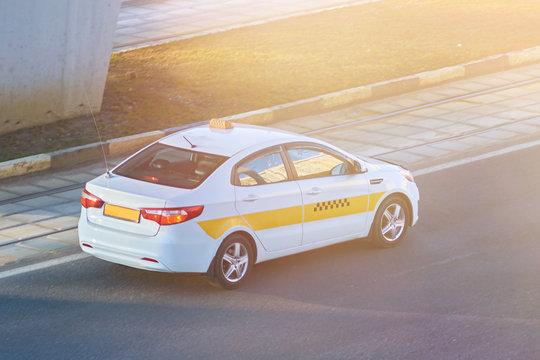 White taxi car in the sun
