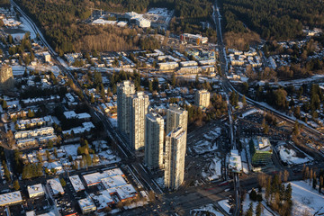 Vancouver, British Columbia, Canada - February 22, 2018: Aerial view of Residential Buildings near Surrey Central Mall during a vibrant winter sunset.