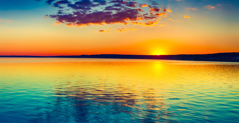 Garden Poster Orange Sunset over the lake. Amazing panorama landscape