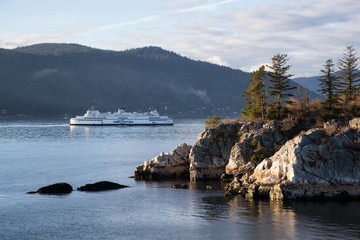 Wall Mural - West Vancouver, British Columbia, Canada - March 06 2018: BC Ferries passing by Whytecliff Park during a vibrant sunset.