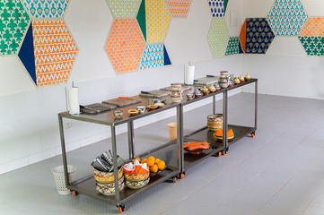 Metallic movable tables with fruits, vegetables and kitchen utensiles