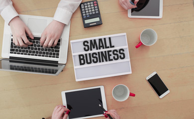 Small business in light box on office desk