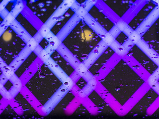 Abstract color neon or led lights background with water drops