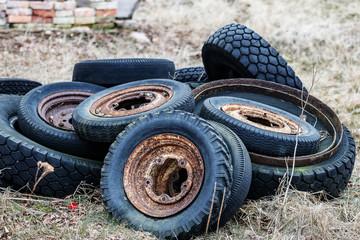 old tyres thrown in the corner of the garden