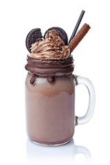 Aluminium Prints Milkshake Crazy chocolate milk shake with whipped cream, cookies and black straw in glass jar