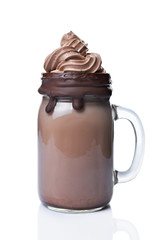 Fotobehang Milkshake Crazy chocolate milk shake with whipped cream, cookies and black straw in glass jar