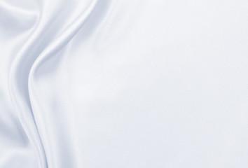 Smooth elegant grey silk or satin luxury cloth as wedding background. Luxurious Christmas background or New Year background design