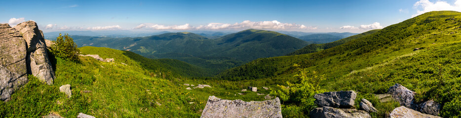 gorgeous panoramic landscape on Runa mountain. summer scenery in beautiful light. huge rocks on a grassy meadow