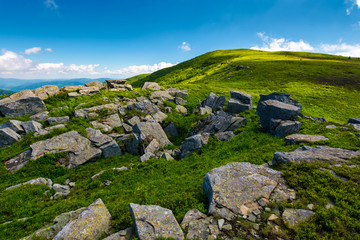 huge rocky formation on the grassy hillside. beautiful landscape of Runa mountain on a bright summer day