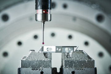 Quality control on milling CNC machine. Precision probe sensor at industrial metalworking Wall mural