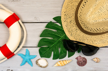 Top view of beach summer accessories with copy space. Traveler accessories. Summer background. Summer beach vacation concept. Flat lay, top view.