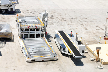 Empty cargo loader wait for commodity from warehouse at airport