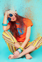Beautiful hippie girl portrait sitting and smoking weed, dispersion effect