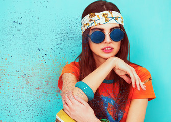 Beautiful hippie girl portrait smoking and wearing sunglasses, dispersion effect