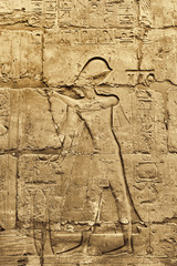 Ancient wall with egyptian hieroglyphs in the Karnak Temple