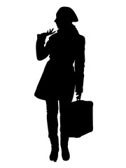 Silhouette of a girl with a suitcase in her hand on a trip.