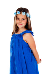 Beautiful small girl with blue dress and a flowers´ wreath on her head