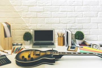 Modern designer desktop with guitar
