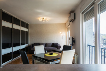 View on modern apartment interior from bar counter