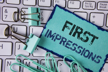 Handwriting text First Impressions. Concept meaning Encounter presentation performance job interview courtship written on Sticky Note paper placed on White Keyboard Clips and Paper Pins next to it.