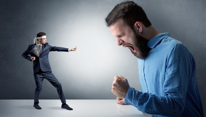 Giant hipster man yelling at a small karate man
