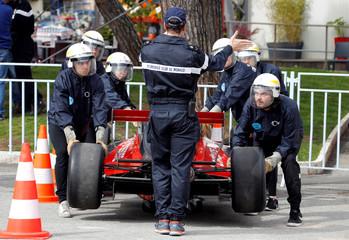 Track marshals train during a drill in preparation for the upcoming Monaco Formula One Grand Prix in Monaco