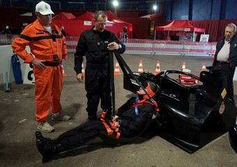 Track marshals perform an extrication exercise as they train during a drill in preparation for the upcoming Monaco Formula One Grand Prix in Monaco