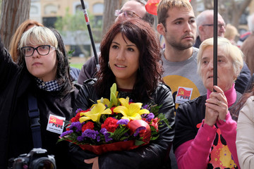 A woman carries a bunch of flowers as Republicans commemorate the 87th anniversary of the declaration of the Second Spanish Republic at the General Cemetery in Valencia